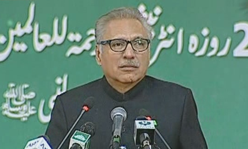 President Alvi  speaking at the two-day international Rehmatul-il-Alameen Conference at Islamabad's Jinnah Convention Centre. — DawnNewsTV