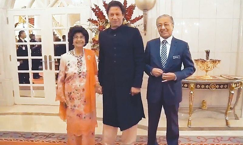 SITI Hasmah, Prime Minister Imran Khan and his Malaysian counterpart Dr Mahathir Mohamad have a laugh after the First Lady asked Mr Khan if she can hold his hand for the photograph.