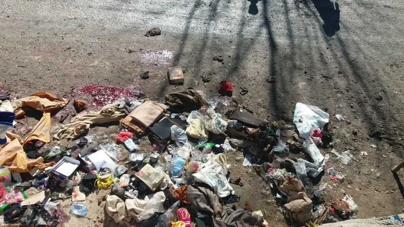 Merchandise from the market where the blast took place are scattered on the street. — DawnNewsTV