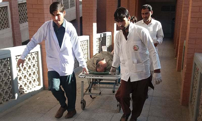 Paramedics transport an injured bomb blast victim to a hospital after the bombing. — AFP