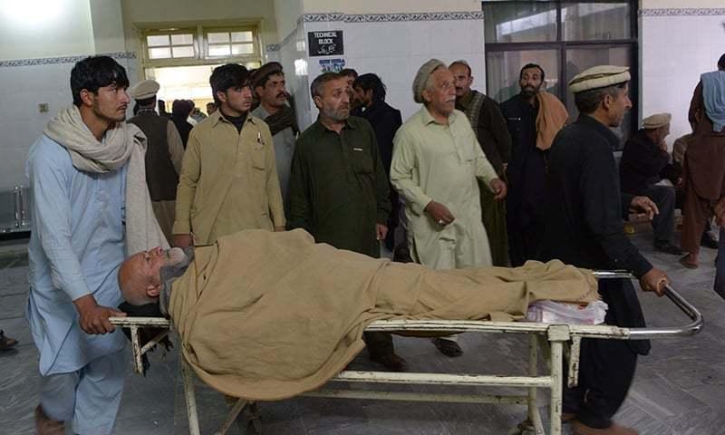Relatives transport an injured bomb blast victim at a hospital. — AFP