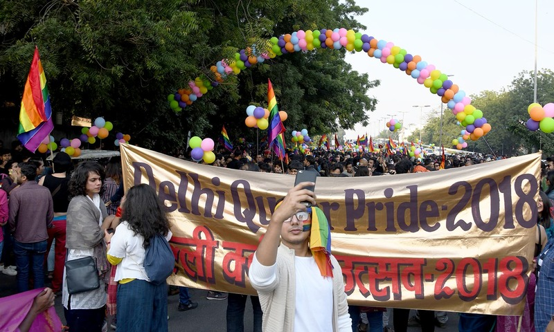 Participants waved rainbow flags and placards emblazoned with Love Wins and Adios a reference to the