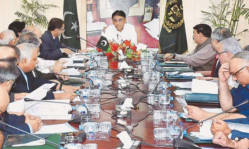 Finance Minister Asad Umar chairs ECC meeting. ─ File photo