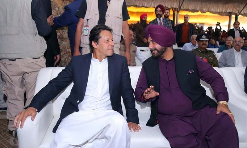 PM Imran Khan talks with Indian lawmaker Navjot Singh Sidhu during the opening ceremony. —PID