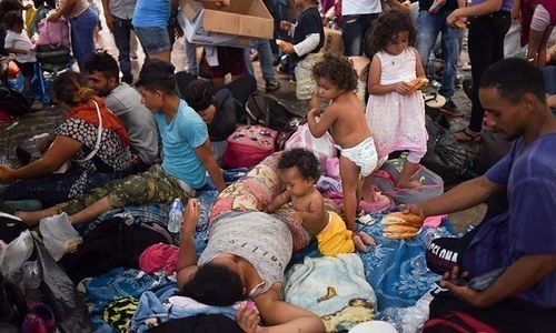 Honduran migrants taking part in a caravan heading to the US, rest at the main square in Tapachula, Chiapas state, Mexico, on October 21. — AFP/File Photo
