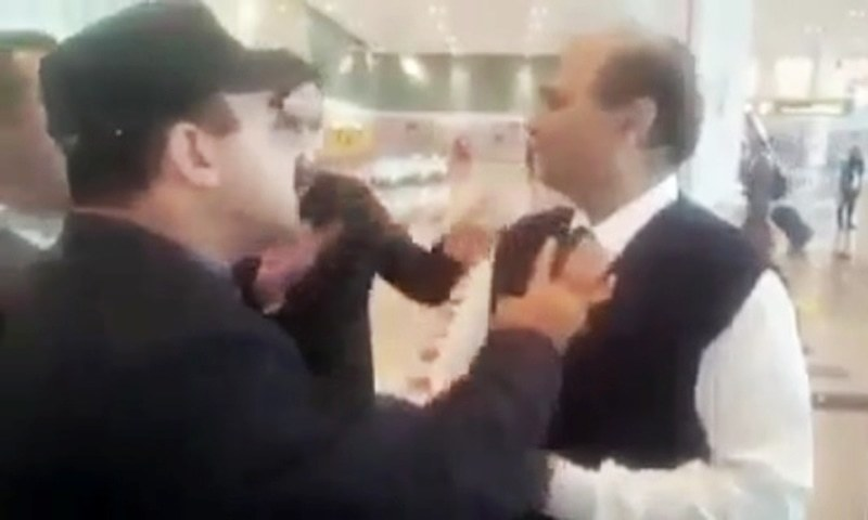 Screengrab from video shows a passenger, believed to be Fida Hussain, allegedly misbehaving with the arrival incharge of Islamabad airport. — Photo courtesy Facebook video