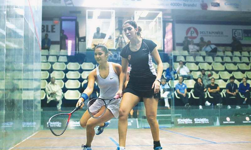 KARACHI: Top seed Yathreb Adel (front) and Rachel Arnold in action during their Pakistan Open Squash Championship match at the Asif Nawaz Squash Complex, DA Creek Club. — Newspaper