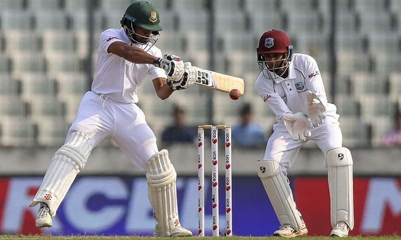 Bangladesh's Shadman Islam (L) plays a shot as West Indies's wicketkeeper Shane Dowrich watches during the first day of the second Test cricket match between Bangladesh and West Indies in Dhaka on November 30, 2018. — AFP