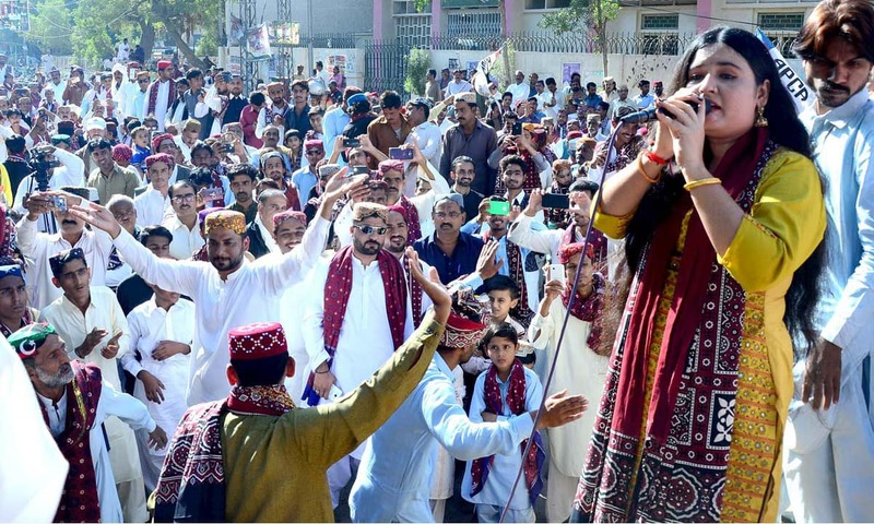 Folk singer performs during a function to mark the Sindhi Culture Day in Hyderabad. —APP