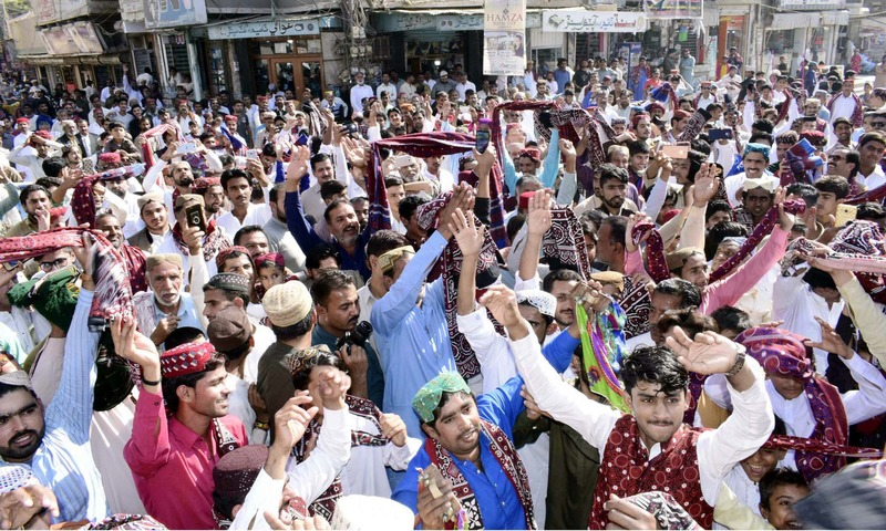People wearing ajrak and Sindhi caps danced to the tunes of Sindhi songs as they moved in rallies. —APP