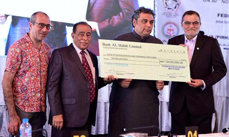Organisers present a donation cheque of Rs10 million for dams fund to Federal Minister Syed Ali Haider Zaidi. —APP