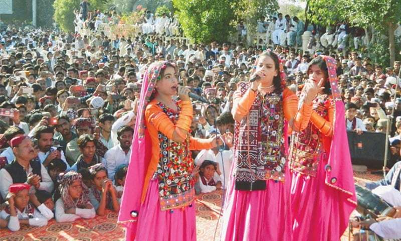 ARTISTS perform at a Sindh Culture Day programme held at the Sindh Museum in Hyderabad on Sunday.—PPI