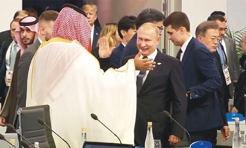 Russian President Vladimir Putin high-fives Saudi Crown Prince Mohammed bin Salman at the G20. — File