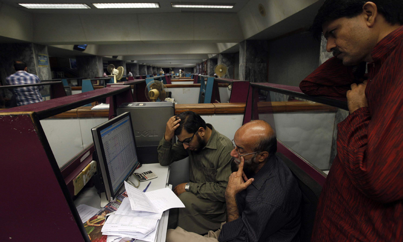 Stockbrokers react as they monitor equity prices at the PSX. — Reuters/File