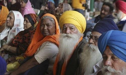 Visiting Indian Sikh pilgrims attend a ceremony in Kartarpur on November 28, 2018.—AP