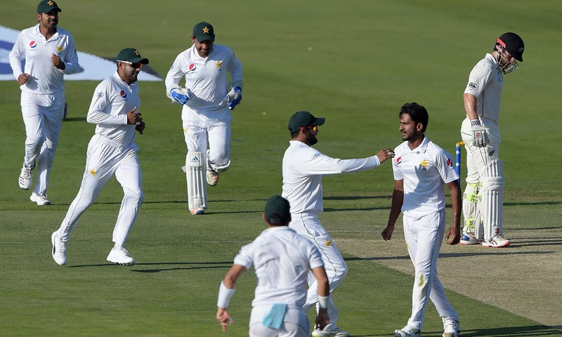 Pakistani cricketers celebrate after the dismissal of New Zealand captain Kane Williamson during the first day of the third and final Test match. —AFP