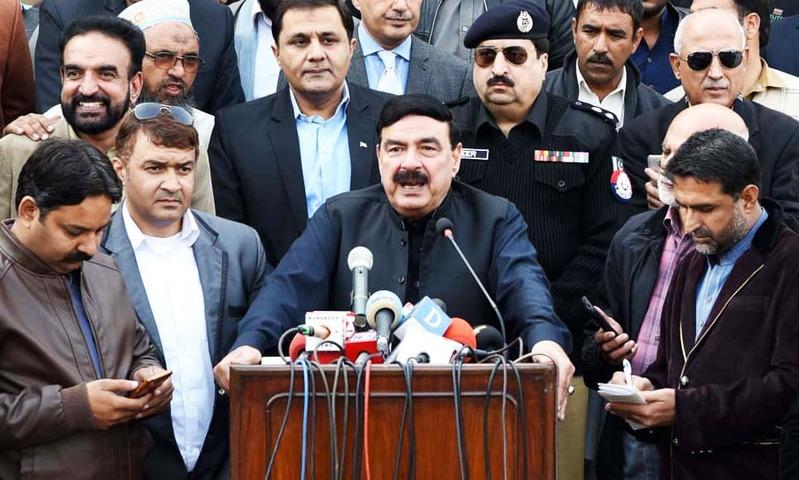 Railways Minister Sheikh Rashid addresses press conference at Rawalpindi Railway Station. —APP