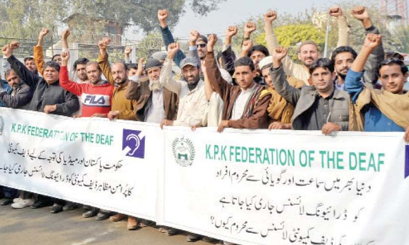 Physically-challenged persons demonstrate outside Peshawar Press Club on Monday to demand driving licence. — White Star