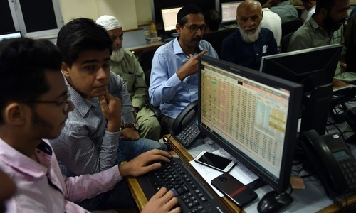 Stockbrokers monitor share prices during a trading session at the Pakistan Stock Exchange. —AFP