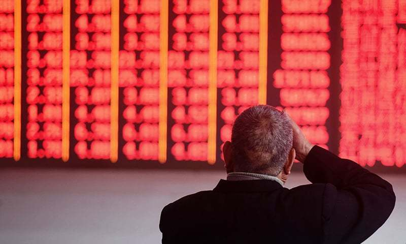 An investor monitors stock prices at a securities company at a securities company in Hangzhou in China's eastern Zhejiang province on December 3, 2018. — AFP/File