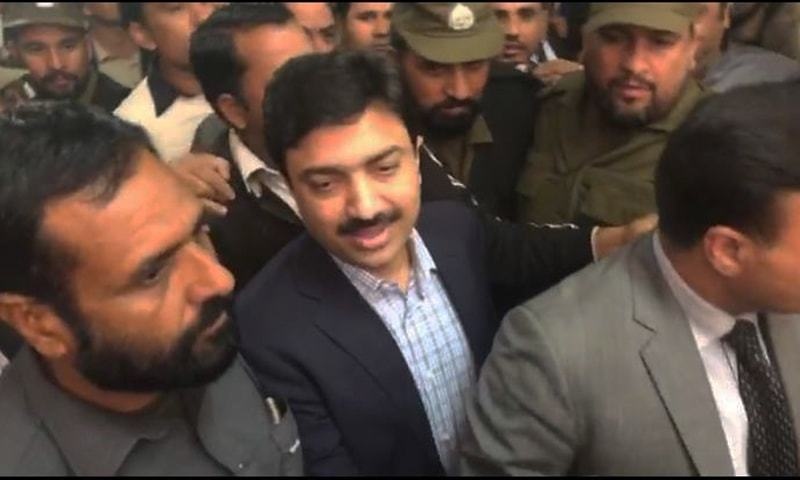 SSP Rai Ijaz pictured while being brought to the court in Lahore. — DawnNewsTV