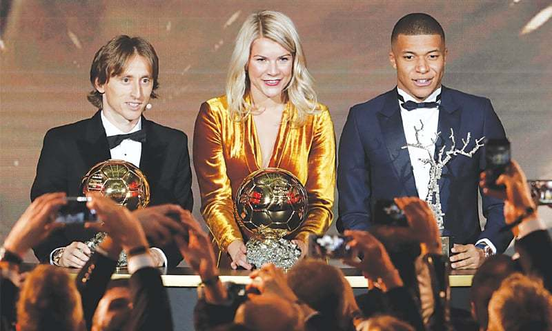 PARIS: Real Madrid's Luka Modric (L), Olympique Lyonnais' Ada Hegerberg (C) and Paris St Germain's Kylian Mbappe pose with their awards during the 63rd Ballon d'Or at the The Grand Palais.—Reuters