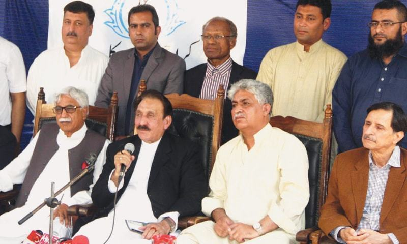 PJDP leadership, including ex-chief justice Itikhar Chaudhry (C) and Abdul Wahab Baloch (2nd left). — File photo