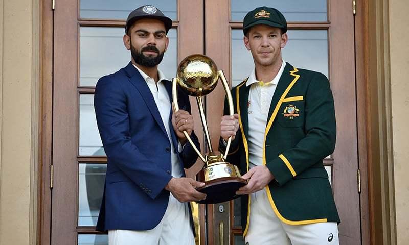 Australia cricket captain Tim Paine (R) and India cricket captain Virat Kohli (L) pose with the Border Gavaskar trophy — AFP
