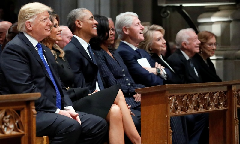 US President Donald Trump, first lady Melania Trump, former President Barack Obama, former first lady Michelle Obama, former President Bill Clinton, former Secretary of State Hillary Clinton, former President Jimmy Carter and former first lady Rosalynn Carter participate in the State Funeral for former President George H W Bush, at the National Cathedral. —AFP