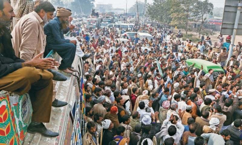 Farmers protest at the Thokar Niaz Beg entrance to the city against increase in fertiliser rates. — White Star