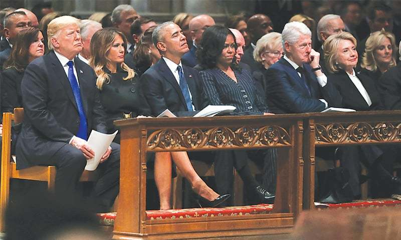 WASHINGTON: US President Donald Trump and first lady Melania Trump with former president Barack Obama, former first lady Michelle Obama, former president Bill Clinton and former first lady Hillary Clinton during the state funeral for president George H.W. Bush.—Reuters