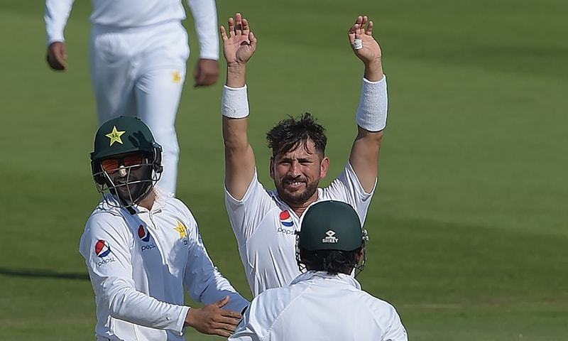 Yasir Shah celebrates with teammates after breaking the fastest to 200 Test wickets record during the fourth day of the third and final Test cricket match between Pakistan and New Zealand at the Sheikh Zayed International Cricket Stadium in Abu Dhabi on December 6, 2018. — AFP