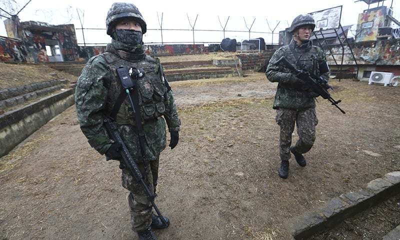 In this file photo, South Korean army soldiers stand guard at a guard post inside the Demilitarized Zone in the central section of the inter-Korean border in Cheorwon, South Korea. — AP