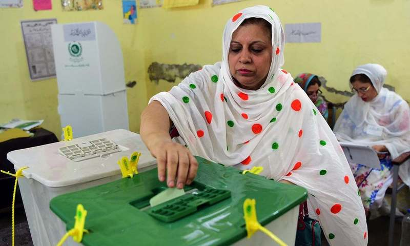 A woman casts her vote at a polling station in Peshawar during the July 25 elections. —Photo by Ghulam Dastageer