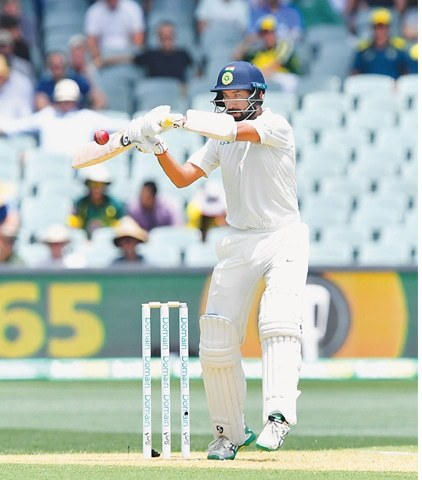 ADELAIDE: Indian batsman Cheteshwar Pujara plays a shot during the first Test against Australia at the Adelaide Oval on Thursday.—AFP