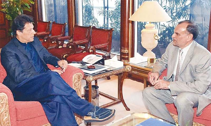 FEDERAL Minister for Science and Technology Azam Khan Swati calls on Prime Minister Imran Khan at the PM Office on Thursday.—INP