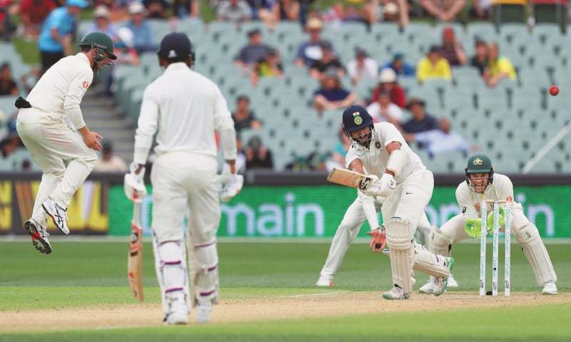ADELAIDE: Indian batsman Cheteshwar Pujara plays a shot through the on-side during the first Test against Australia at the Adelaide Oval on Saturday.—AP