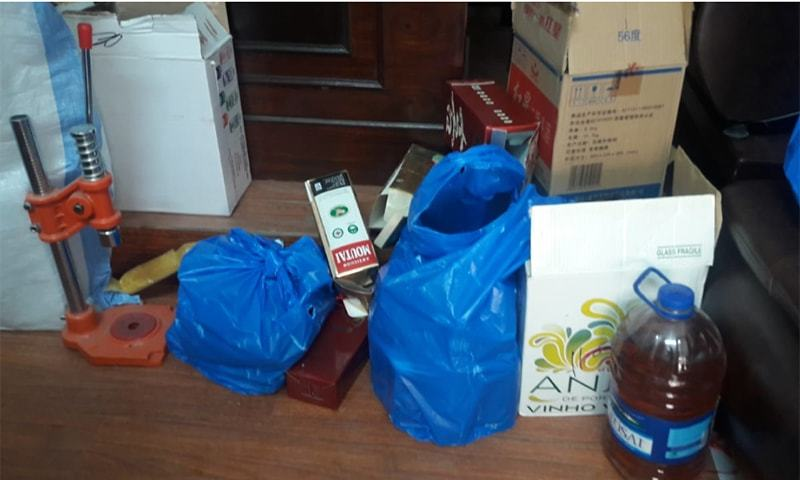 Large quantities of beer of various brands, as well as machinery to brew the alcohol were recovered from the house where the manufacturing unit had been established. — Photo courtesy of Islamabad Police