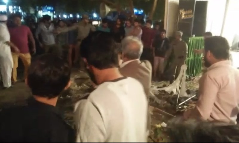 People are seen at the site of the blast in Gulistan-e-Jauhar area on Saturday night. — DawnNewsTV