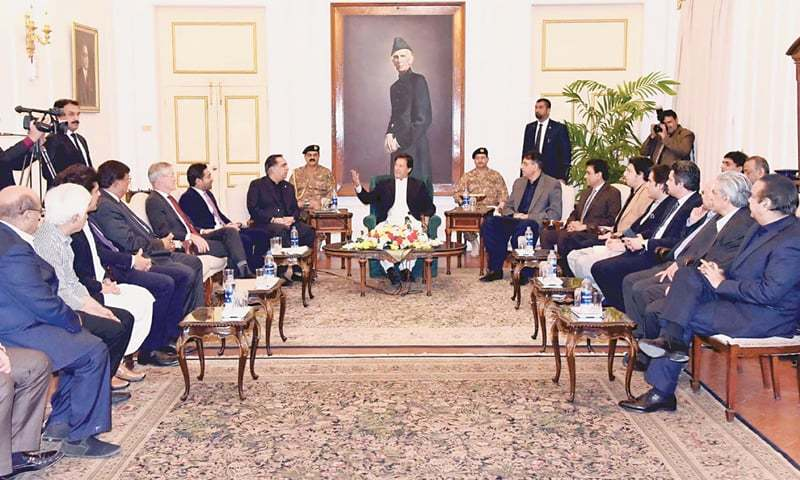 KARACHI: Prime Minister Imran Khan meets a delegation of the Pakistan Stock Exchange at the Governor House on Sunday.—APP