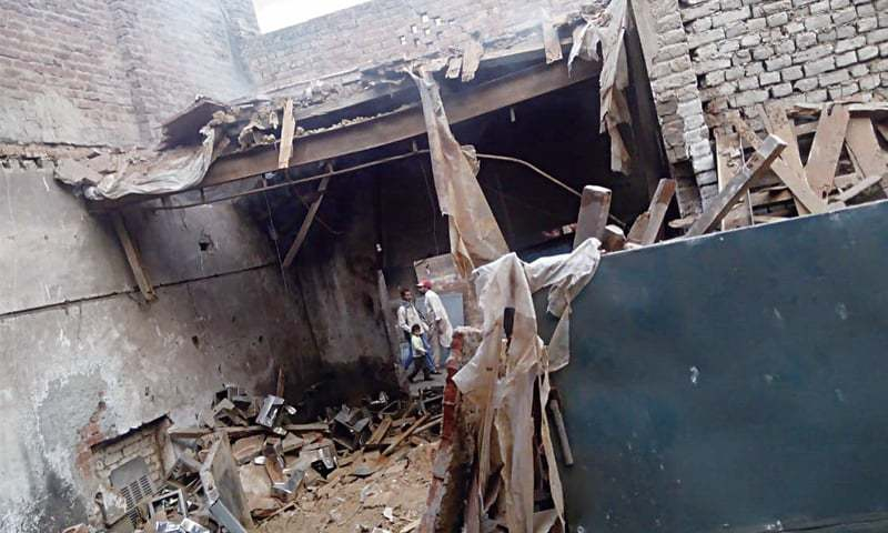 GUJRANWALA: The roof of a factory collapses in Baghbanpura area due to a chemicals explosion. — Dawn