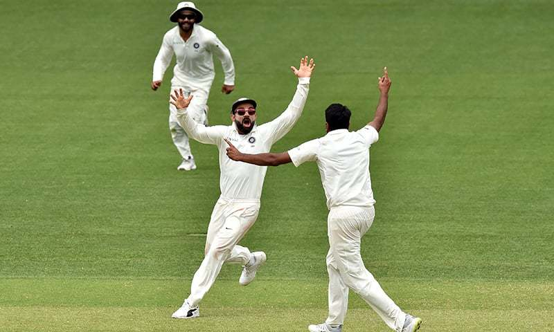 India's captain Virat Kohli (C) cleberates India's victory in the first Test cricket match against Australia with teammates. — AFP