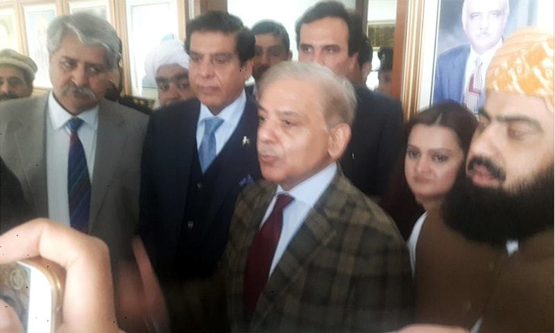 Opposition leader Shahbaz Sharif talks to reporters in the parliament alongside leaders of other opposition parties. — Photo by author