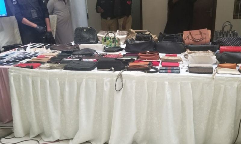 Cash, dozens of valuable women's handbags and jewelry worth hundreds of thousands were recovered. — Photo courtesy of author