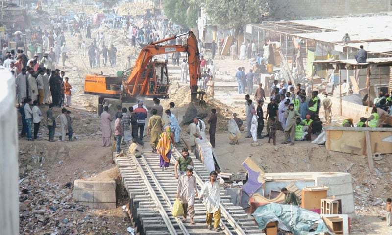 KARACHI: Heavy machinery being used to demolish encroachments at the circular railway's land in the city's Gharibabad area. An operation to remove 5,600 illegal structures on railway land began on Tuesday.—Online