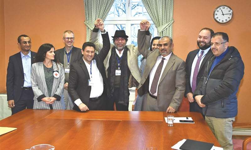 Stockholm: Representatives of the Houthi delegation (left) and those of the Yemeni government pose for a picture with officials from the UN Special Envoy's office and the Red Cross during the peace talks.—AFP