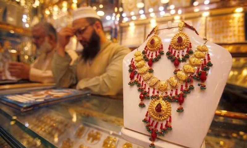 Salesmen at a jewellery shop are awaiting customers in this file photo.
