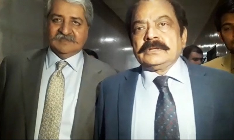 PPP's Naveed Qamar (L) and PML-N's Rana Sanaullah speak to reporters at the parliament after a meeting with a government delegation. — Screengrab