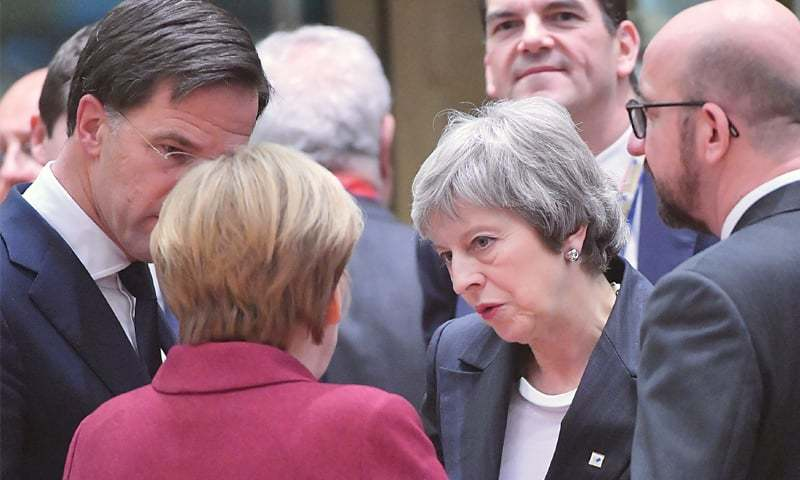 BRUSSELS: British Prime Minister Theresa May conferring with some of the European leaders on Thursday.—AFP