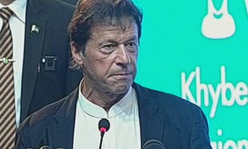 Prime Minister Imran Khan speaks at an event upon completion of KP government's 100 days in office on Friday. — DawnNewsTV